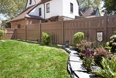 "V500A-6 Semi-Privacy Fence with Alternating 1-1/2"" & 6"" Wide Boards. Shown in Illusions Vinyl Fence's Grand Illusions Color Spectrum Landscape Series Brownstone (E112)."