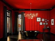 Nice use of red and black.  The high ceiling makes the heavier decor work better.