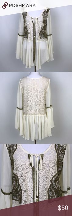"""[Free People] Embellished Boho Blouse Lace Beaded Beautiful cream boho blouse. Long bell sleeves. Keyhole with tie at front. Lace crochet panels embellished with bronze beading. Metallic trim on sleeves. Sheer. Loose fit.  🔹Fabric: Cotton, Nylon, Polyester  🔹Bust: 38"""" 🔹Length: 30"""" 🔹Condition: Excellent pre-owned condition. Free People Tops Blouses"""