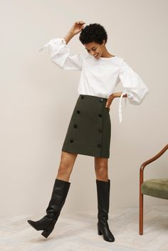 If you love a white tee and mini skirt this is your fall outfit