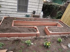 Similar to another raised bed I pinned, but this one looks like they have it set up with a stepping stone and flower area in the front of it.