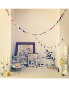 Party Ready - We love how @rushkaonline mixed playful heart-shaped garland with vintage-looking egg prints in this festive Easter nook.