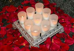 Inexpensive picture frames could be spray painted to match and used as a base (tray) for center pieces