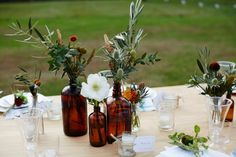Brown bottles with wildflower arrangements