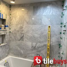 """Gray marble shower tub combo remodel. Shower walls are Carrara Venato Marble 12""""x24"""" Field Tile. Honed, polished, brushed finishes available. Also pictured: Carrara white marble mosaic tile shower niche - oversize diamonds pattern with Cinderella Grey marble accent dots + Carrara Venato pencil trim. Marble tile bathroom remodel, DIY bathroom remodel, DIY bathroom storage, marble shower shelves with Carrara pencil trim. Carrara Marble Bathroom, Honed Marble, Marble Wall, Backsplash Marble, Gray Marble, Marble Mosaic, Kitchen Backsplash, Shower Floor Tile, Tub Shower Combo"""