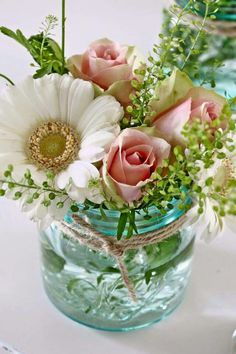 These 12 Gorgeous DIY Mason Jar Flower Arrangements are perfect all year around. Great floral on the cheap. Make your home beautiful, fresh and inviting by adding pops of colour and lush floral combinations in gorgeous Mason Jars! Mason Jar Flower Arrangements, Mason Jar Flowers, Floral Arrangements, Table Arrangements, Flower Jars, Beautiful Flower Arrangements, Diy Wedding Flower Arrangements, Green Mason Jars, Small Flower Bouquet