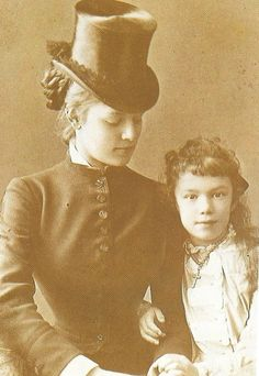 Countess Marie Louise Larisch-Wallersee in a riding habit with a young girl, 1880's