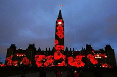 A virtual Drop of 117,000 Poppies (1 for each of Canada's Fallen), projected on the Peace Tower & Centre Block on Parliament Hill, in Ottawa. The virtual Poppy Drop is a stunning, large-scale reminder of the sacrifices of Canada's Veterans