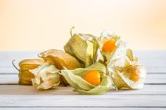 Physalis peruviana berries on a table by Kasper Nymann