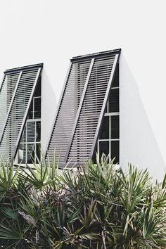 Beautiful black lockers sun screens costal style island living (The Veda House Blog)