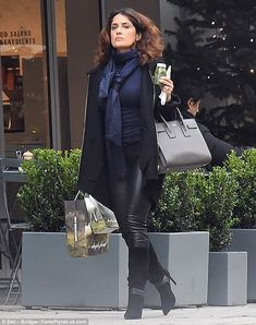 Going green: The stylish actress sipped on a healthy-looking drink as she made her way dow...