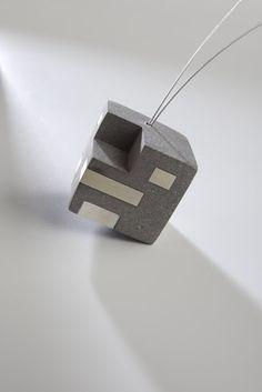Holcim Art - Functionnal house concrete necklace