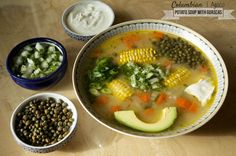 A true staple of Colombian cuisine, this ajiaco recipe is a delicious, wholesome and nourishing soup featuring guascas, a critical herb to the region