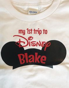 "No better way to celebrate your first trip to Disney World or Disneyland than with these matching family Disney vacation youth t shirts! All shirts have a silhouette of the Mickey Mouse ears hat with the family member's name on it. Above the name the shirt says, ""my 1st trip to Disney."" These shirts are available in white with red lettering and red with white lettering. You can even choose to have each person's name in glitter! To make sure the shirts come out exactly as you want them…"