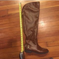 Over the knee brown leather riding boots. Super cute over the knee riding boots with brown buckles detail. I've worn them a few times but they are in perfect condition. They have a zipper running up the back and would work great on somebody with wider calves. A tad slouchy on little calves but still cute-I have chicken calves and you can see how they fit on me. Bought from Modcloth. Shoes