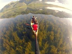 canoeing in a crystal clear lake