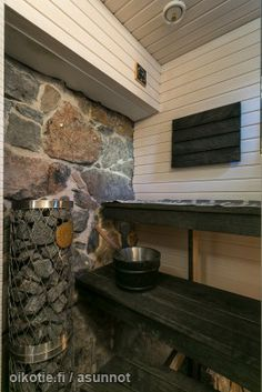 Sauna, stone walls and black wood