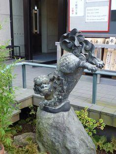 Handstanding Koma-Inu (Shrine dog) stature - Shuzenji temple in Shuzenji, Izu, Shizuoka prefecture, Japan