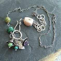 Chunky, funky bouquet necklace in a lively combo-platter of bright green, pale pink, turquoise and purple gemstones