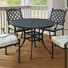 5cfe3abe7de3 Dine in the comfort of your own backyard with this spacious and sturdy  round table. The metal construction showcases basket weave detailing that  comes ...