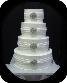 Elegant White Wedding Cake with Silver Jewelry by Graceful Cake Creations, via Flickr