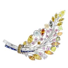 Natural Fancy Color Diamond Feather Pin | From a unique collection of vintage brooches at http://www.1stdibs.com/jewelry/brooches/brooches/