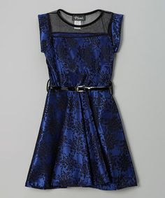 Grown-up charm meets playful style with this lovely lace dress. The full skirt gives it a gracefully flowing flair, while a mesh yoke and belt finish off this mod look.
