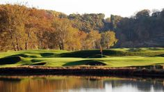 Pete Dye River Course - hole # 11 across the pond with # 16 green in the background.