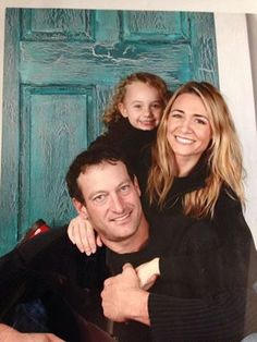 Troy Kostur, Deanne Bray, and their daughter Kyra