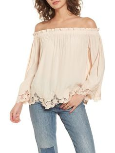 analena off the shoulder blouse by ASTR the Label. You might be tempted to take a spin in this fluid off-the-shoulder blouse topped with tiny ruffles and hemmed with da...