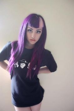 I know it's super bold, but I love love love this shade of purple for hair! I want to do something similar (but without the blond bangs)