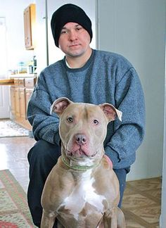 Pit Bulls saves his human's life as he slips toward a coma.
