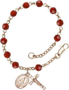 14kt Gold Filled Rosary Bracelet features 5mm Garnet Swarovski beads. The Crucifix measures 5/8 x 1/4. Each Rosary Bracelet is presented in a deluxe velvet gift
