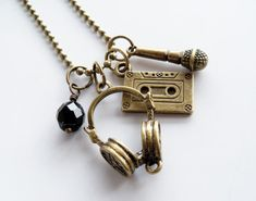 Items similar to Music Charm Necklace - Musician Jewelry - DJ Necklace - Singer - Headphones Cassette Microphone Charm Pendant - Gift For Music Lover Singer on Etsy Music Jewelry, Etsy Jewelry, Cute Jewelry, Jewelry Accessories, Jewelry Necklaces, Jewelry Design, Designer Jewelry, Charm Bracelets, Jewelry Ideas