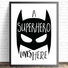 A Superhero Lives Here Nursery Print. Bedroom Decor Wall Art Print PRINT DETAILS- Available in two standard sizes for easy framing. prints are printed on 250 gsm archival, matte photo paper. For our larger prints, we use 192 gsm archival, matte photo Batman Nursery, Batman Wall Art, Batman Bedroom, Superhero Wall Art, Bedroom Prints, Nursery Prints, Bedroom Decor, Bedroom Wall, Bedroom Ideas