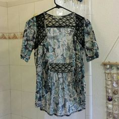 Rose Print/Lace Top Never worn! Will fit an x-small to small. Nicolette Tops