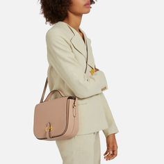 Shop the Tenby in Rosewater Goat Leather at Mulberry.com. The Tenby is combination of classic and contemporary: a classic satchel shape that feels traditional and timeless, with modern versatility thanks to its cross-body shoulder strap. With both the adjustable strap and top handle the Tenby can be worn in multiple ways, and its new tab lock is inspired by a piece from our archives for another 'new nostalgic' twist.