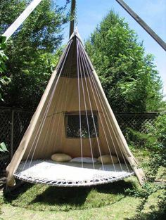 DIY hanging tent made with a trampoline as the base