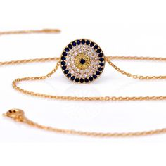 "Evil Eye Protection Necklace  Gold plated over .925 silver evil eye necklace with quality cubic zirconia stones in blue, yellow and clear.  Wear this necklace for good luck and protection, and because it looks fantastic!  Chain measures approx.: 16""  Evil Eye pendant: 0.59""           ..."