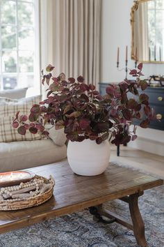 Elevate your space this fall, with permanent botanicals from Afloral. Simply fill a vase with these burgundy faux falls leaves for a simple seasonal refresh. Shop this look by @jennasuedesign at Afloral.com.
