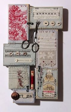 """Fragments of collected haberdashery are hand stitched onto """"patches"""" of wood. These patches are then stitched together to create my unique take on a traditional patchwork sampler."""