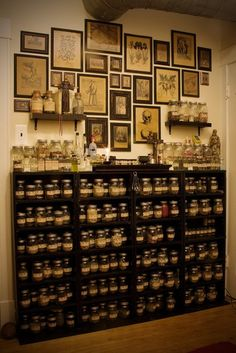 Mother Phoenix: I already have all of my herbs jarred and labeled just like this...and I have these black shelves...but I love this set up way better!!! I can't wait to do this! Herb jars & plant pictures/information