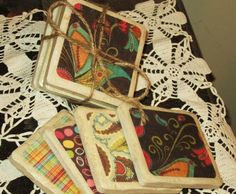 4x4 natural stone tile coasters using scrapbook paper, modge podge and cork for the back..what a cool gift idea.