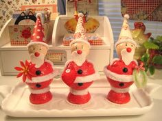 santas: a pictorial tutorial-she uses paper clay to cover the body