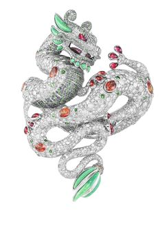 Harumi for Chopard Dragon bracelet features rubies, diamonds, emerald and turquoise and fuses the major cultural symbols of the Chinese dragon with the Aztec plumed serpent.