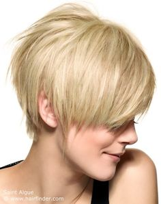 "love the long layers and shape of this one,,,, ""The lines are blurred and jagged with feisty delight. Layers, a short neck and a disconnect over the ear add more spice to the short blonde look of wonder. It is modern in all of its aspects and does not lack in the attitude department. """