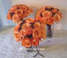 Orange rose bouquets for attendants (yours will have peach hypericum and be slightly smaller)