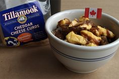Slow cooker poutine. The common Canadian dish is originally from Quebec and consists of French fries, gravy, and cheese curds! …