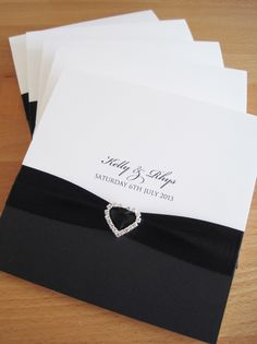 Albany Pocketfold Wedding Invitations in white and black and finished with black ribbon and a crystal heart.