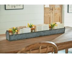 This metal trough is a great rustic farmhouse decoration to display fruit, flowers or any other creative decoration! Tabletop centerpiece designed by Joanna Gaines / Magnolia Home. Galvanized Trough, Metal Trough, Cheap Furniture, Furniture Decor, Furniture Market, Modern Furniture, Chicken Feeder Decor, Rustic Planters, Autumn Table